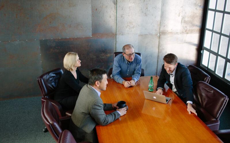 01-team-in-meeting-room